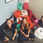 WestCMR and Caring Partners International Team Up to Send Backpacks to Students in Need